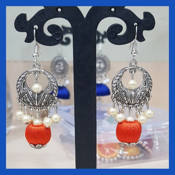 Silver colored Chand Bali with white pearl and Orange Silk ball
